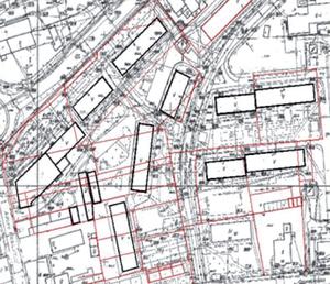 Fragment osiedla spółdzielni mieszkaniowej; w tle granice działek ewidencyjnych - kolor czerwony