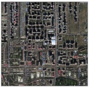Deepfake w teledetekcji. Jak się bronić przed fałszywymi zdjęciami satelitarnymi? <br /> Przykład zdjęcia satelitarnego wygenerowanego przy użyciu deepfake (fot. Zhao et al., 2021, Cartography and GIS)